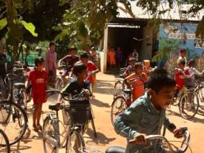 Receiving their brand new bicycles.