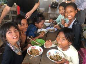 Enjoying their meal at our Khmer New Year party.