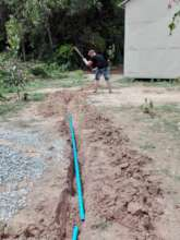 Installing the plumbing for our Water Project
