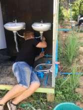 Volunteer Tom working on the plumbing!
