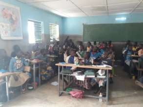 Students in Classroom, LED light on (ceiling)