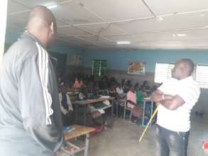 School teachers in classroom with students