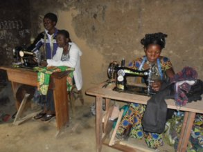 Former child soldiers learn to use sewing machines