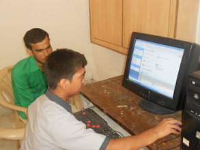 Harshit learning to use the computer.JPG