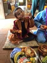 Badi Ram enjoys his treats at Ma Pujha