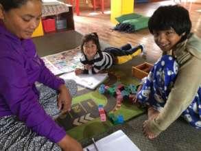 "Ganga ""studies"" while her sister is tutored."