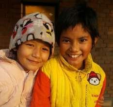 Pooja (left) and her new sister Alysha