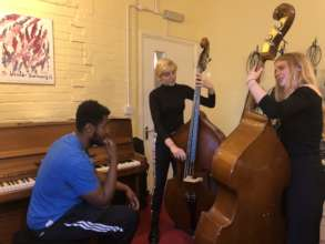 Bass players at World Heart Beat