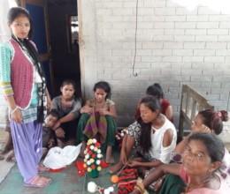 Phulmaya teaching weaving in her local place