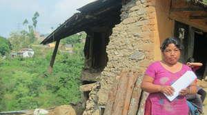 Grantee partner Esha Tamang infront of her home