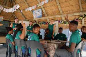 Children and Volunteers in Classroom