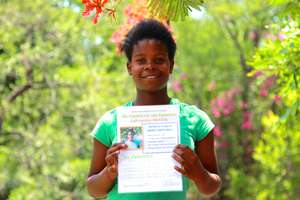 Receiving her diploma after a week at DAKTARI!