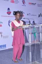 Student presenting her speech at IEEE Summit 2015