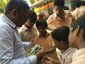 Arun working with his students