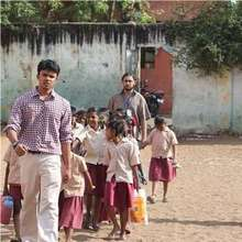 Fellow in North Chennai leading his students