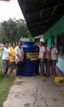 Teachers  at Catig-Lacadon with new water tank