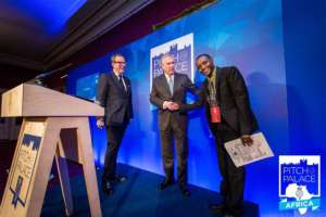 Hilonga receiving the award from Prince Andrew, UK