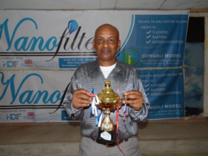 Local Entrepreneur holding Nanofilter victory cup