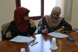 Students filling out applications in Gaza
