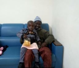 Yunusa and his dad waiting for surgery