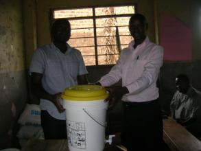 Luwala primary school receiving a water purifier