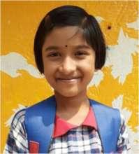 Poushali* in a joyful smile