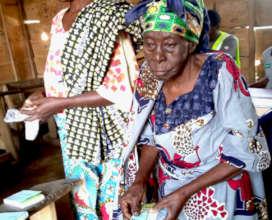 Displaced women prepare to submit vouchers