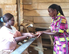 At the final station, a woman receives cash