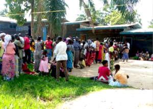 Displaced families wait for cash handouts