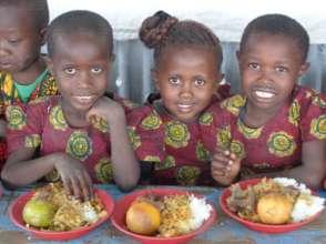 Smiling girls during our weekly Kenya Heritage Day