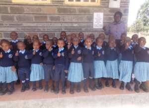 The LLK Kids are proud of their school uniforms