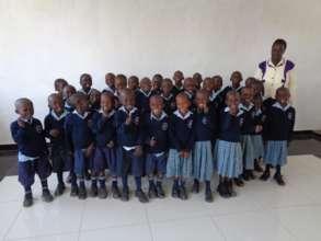 Preschool pupils and their teacher