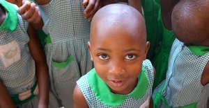 A student at Kutamba Primary School