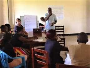 Jackson, Nyaka Founder & ED, leading a discussion