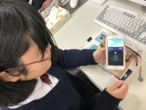 A student checks the partner school's weather