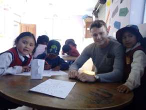 Students with volunteer John