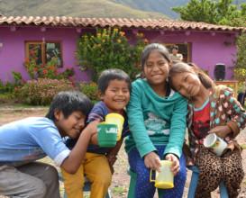 Picaflor kids enjoying Christmas hot chocolate