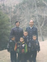 Lun, right, with his grandparents & three brothers