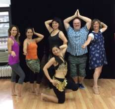 Volunteer Peter Taghe belly dances for Bolivia