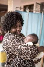 Dr. Pasquine Oygunsanya with an HIV-free baby
