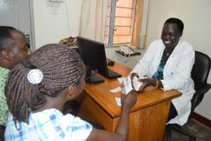 Sr Beatrice counseling a client and her partner