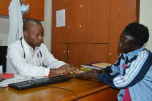 Linda receives medication from a clinical officer