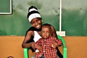 Mother, Jenifer, holding HIV negative son Dathan