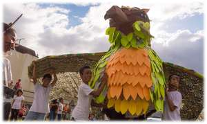 A Festival Bird with local children