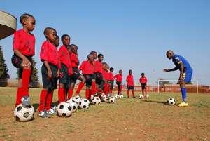 Children line up for Warm Up at Soweto HA