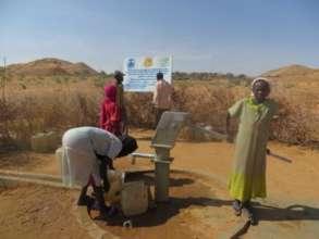 Collecting Water from Handpump