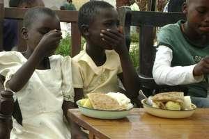 Childrenof Teen Mothers enjoying Christmas Meal