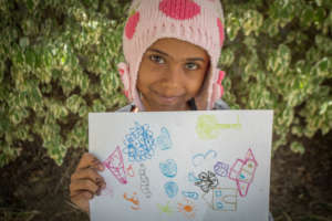 Razan, a year later in recovery