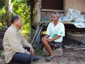 TPO Counselor visiting a client in a rural area
