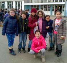 Smiling Asja and Jasmine with their school peers